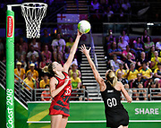 11th April 2018, Gold Coast Convention and Exhibition Centre, Gold Coast, Australia; Commonwealth Games day 7; Netball, England versus New Zealand; Jo Harten of England outreaches Katrina Grant of New Zealand