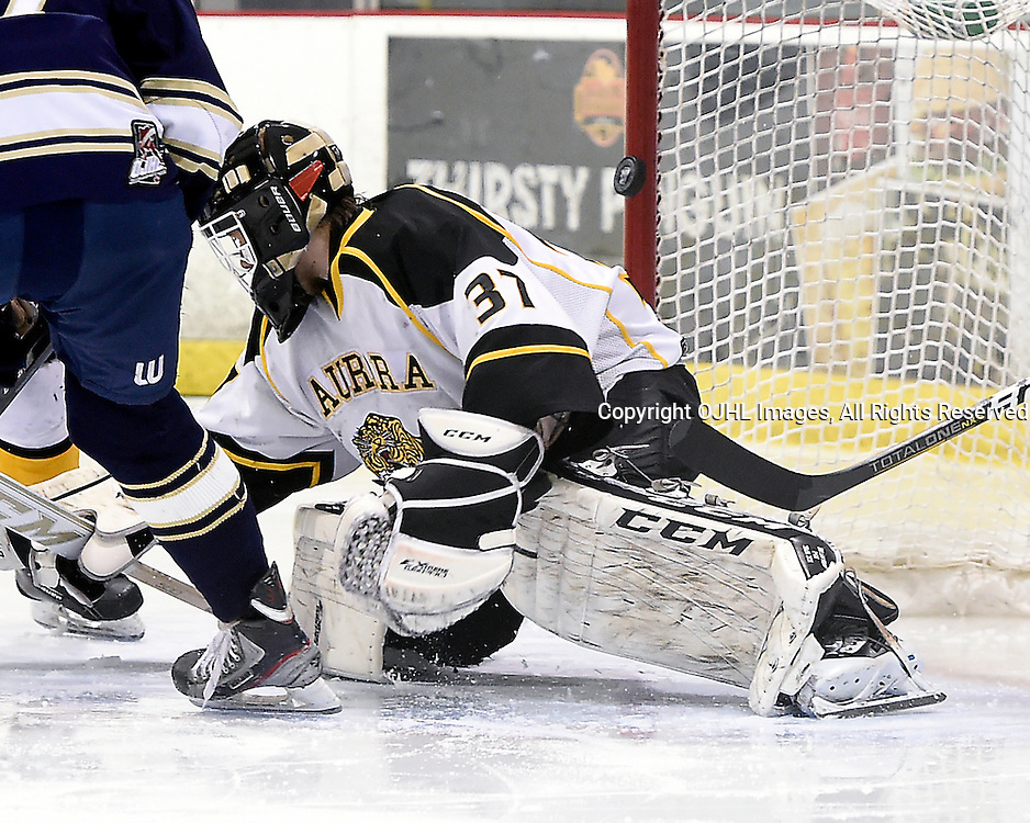 TORONTO, ON - Apr 10 : Ontario Junior Hockey League, Buckland Cup Championship Series between the Aurora Tigers and the Toronto Lakeshore Patriots, Kevin Entmaa #37 of the Aurora Tigers protects the crease during second period game action.<br /> (Photo by Andy Corneau / OJHL Images)