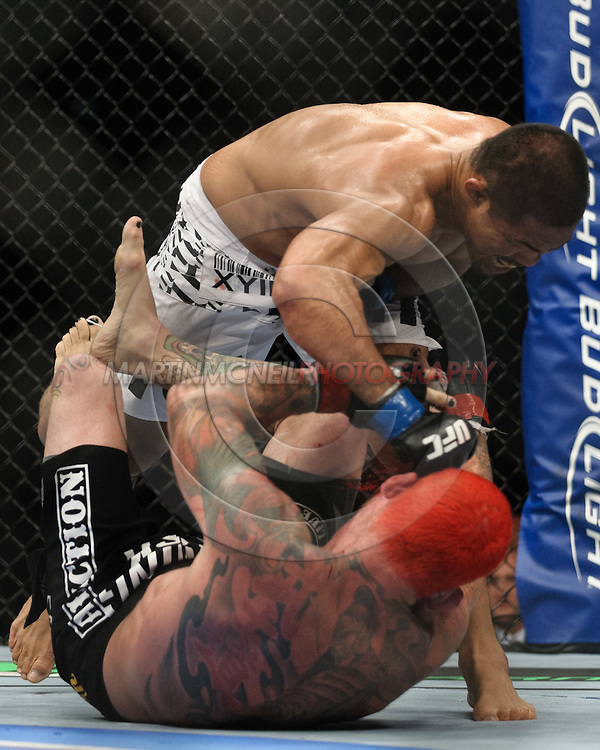 "BIRMINGHAM, ENGLAND, NOVEMBER 5, 2012: Mark Munoz (top) is relentless in his assault on Chris Leben during ""UFC 138: Munoz vs. Leben"" inside the National Indoor Arena in Birmingham, United Kingdom"