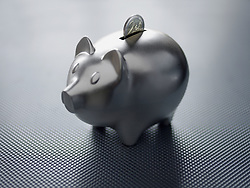 Dec. 14, 2012 - Two euro coin in a piggy bank (Credit Image: © Image Source/ZUMAPRESS.com)