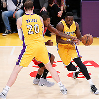 26 October 2016: Los Angeles Lakers forward Luol Deng (9) drives past Houston Rockets forward Trevor Ariza (1) on a screen set by Los Angeles Lakers center Timofey Mozgov (20) during the Los Angeles Lakers 120-114 victory over the Houston Rockets, at the Staples Center, Los Angeles, California, USA.