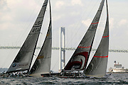 USA, Newport, RI 2004 - America's cup boats race for the UBS trophy in front of the Newport Bridge.