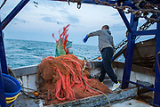 Luke, throwing the nets in to begin trawling. Luke is a Folkestone based fisherman out trawling for a 12 hour night shift on a fishing trip in his boat Valentine (FE20), Hythe Bay, the English Channel, United Kingdom.(photo by Andrew Aitchison / In pictures via Getty Images)