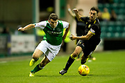 Hibernian midfielder John McGinn (#7) and Livingston midfielder Shaun Byrne (#6) battle for the ball during the Betfred Scottish Cup match between Hibernian and Livingston at Easter Road, Edinburgh, Scotland on 19 September 2017. Photo by Craig Doyle.