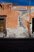 A door facing the street leading to the city center of San Miguel de Allende, Mexico. A lavanderia or Mexican laundry.