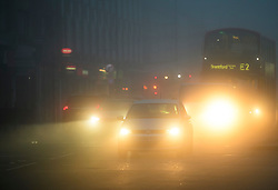 © Licensed to London News Pictures. 22/12/2016. London, UK. Traffic makes it's way along Ealing Broadway in West London in thick fog on a cold winter morning. Temperatures over the upcoming Christmas period are expected to be unusually warm. Photo credit: Ben Cawthra/LNP