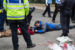 London, UK. 6 September, 2019. Climate activists, locked together using an arm tube in one of the two main access roads to ExCel London, on the fifth day of a week-long carnival of resistance against DSEI, the world's largest arms fair. The road remained blocked for several hours. The fifth day of protests was themed as Stop The Arms Fair: Stop Climate Change in order to highlight links between the fossil fuel and arms industries.