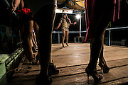 Transvestites perform fashion show during folkfore perfomance in Mojokerto, East Java, Indonesia, June 7, 2015. The group has improvised dealing with the modernity to survive.