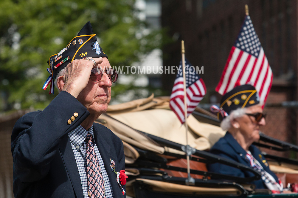 Middletown, New York - Grand Marshall Edward Collins salutes during the Middletown-Town of Wallkill Memorial Day parade on  May 25, 2015.