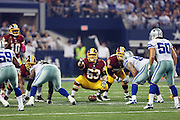 Washington Redskins center Will Montgomery (63) gets set to snap the ball during the NFL week 6 football game against the Dallas Cowboys on Sunday, Oct. 13, 2013 in Arlington, Texas. The Cowboys won the game 31-16. ©Paul Anthony Spinelli