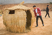 LUOYANG, CHINA - MARCH 16: (CHINA OUT) <br /> <br /> A citizen looks in a straw house at a construction site on March 16, 2016 in Luoyang, Henan Province of China. Various straw dolls like dinosaurs, ducks, Minions, elephants, pandas and small trains as well we others are made at a construction site which attracted citizens and visitors.<br /> ©Exclusivepix Media
