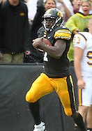 September 3, 2011: Iowa Hawkeyes wide receiver Marvin McNutt (7) runs down the sidelines after a catch during the first half of the game between the Tennessee Tech Golden Eagles and the Iowa Hawkeyes at Kinnick Stadium in Iowa City, Iowa on Saturday, September 3, 2011. Iowa defeated Tennessee Tech 34-7 in a game stopped at one point due to lightning and rain.