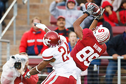 October 23, 2010; Stanford, CA, USA;  Stanford Cardinal wide receiver Doug Baldwin (89) catches a pass over Washington State Cougars defensive back Daniel Simmons (24) for a touchdown during the third quarter at Stanford Stadium.  Stanford defeated Washington State 38-28.
