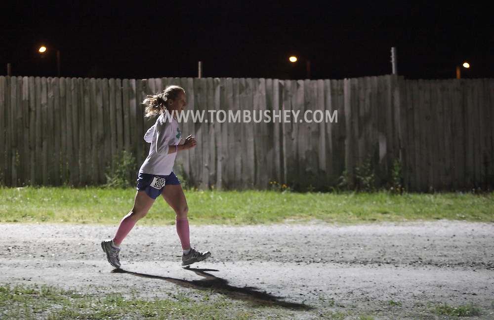 Augusta, New Jersey - Aubrey Blanda runs at night during the 3 Days at the Fair races at Sussex County Fairgrounds on May 15, 2010. Blanda finished first in the women's 12-hour race.