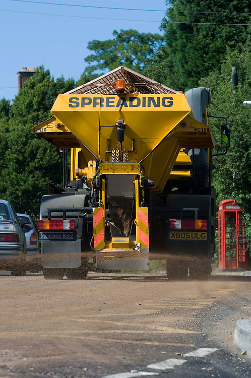 Road gritters spread sand on Tarmac roads that are melting, in the heatwave, Marchington, Staffordshire, United Kingdon