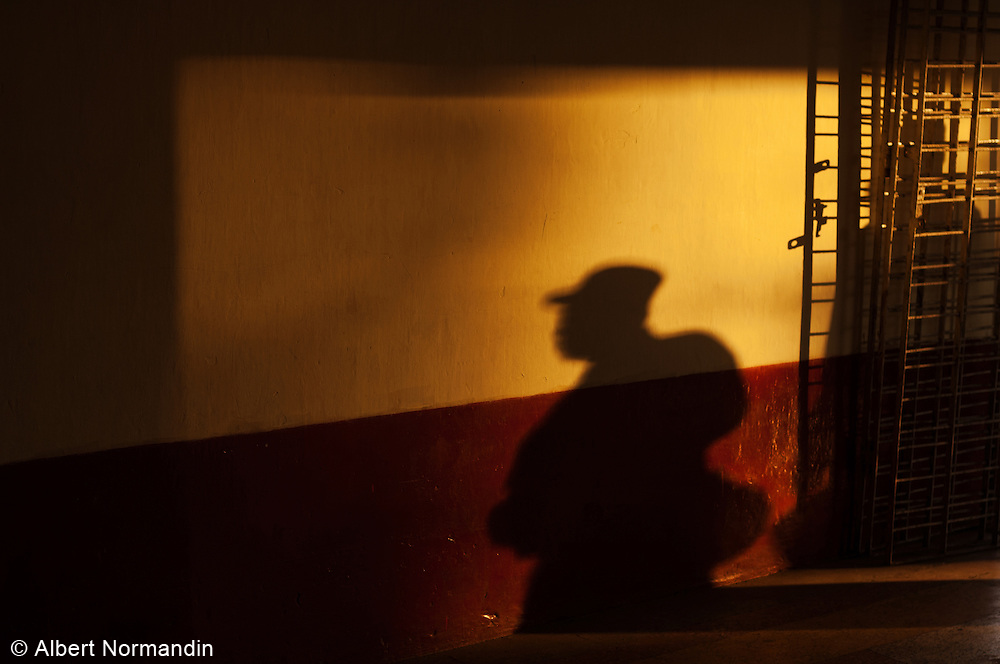Shadow of worker at train station at sunrise