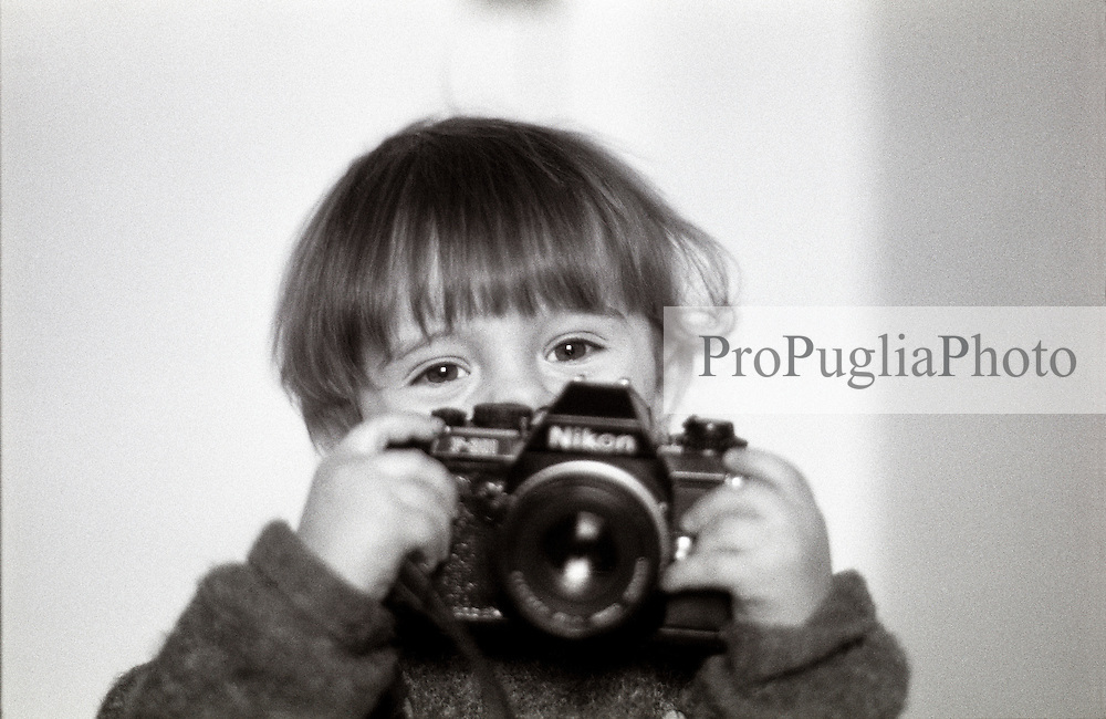 London, February 2004. Gabriele is exploring photography. Well,,,, let's say he likes very mutch to play with his dad's cameras cameras. However, he takes pictures already! .Ps He his holding a film camera Nikon F301