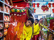 "19 FEBRUARY 2015 - BANGKOK, THAILAND: Chinese dragon dancers perform for Chinese New Year in a business on Yaowarat Road in Bangkok. 2015 is the Year of Goat in the Chinese zodiac. The Goat is the eighth sign in Chinese astrology and ""8"" is considered to be a lucky number. It symbolizes wisdom, fortune and prosperity. Ethnic Chinese make up nearly 15% of the Thai population. Chinese New Year (also called Tet or Lunar New Year) is widely celebrated in Thailand, especially in urban areas that have large Chinese populations.    PHOTO BY JACK KURTZ"