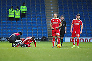 Swindon Town midfielder Louis Thompson receives treatment during the Sky Bet League 1 match between Chesterfield and Swindon Town at the Proact stadium, Chesterfield, England on 28 November 2015. Photo by Aaron Lupton.