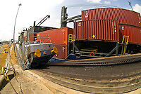 Locomotives pull a container ship through the Miraflores Locks, Panama Canal, Panama