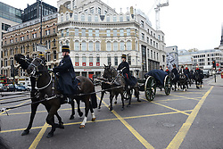© Licensed to London News Pictures.30?11/2013. London, UK. Sacred soil from the battlefields of Flanders has been carried on a gun carriage at Fleet Street. The soil arrived yesterday on a Belgian frigate and was loaded on to a gun carriage this morning. The gun carriage was drawn by six colour matched black Irish Draught horses and was taken to Wellington Barracks.Photo credit : Peter Kollanyi/LNP