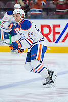PENTICTON, CANADA - SEPTEMBER 16: Thomas Foster #64 of Edmonton Oilers warms up against the Vancouver Canucks on September 16, 2016 at the South Okanagan Event Centre in Penticton, British Columbia, Canada.  (Photo by Marissa Baecker/Shoot the Breeze)  *** Local Caption *** Thomas Foster;