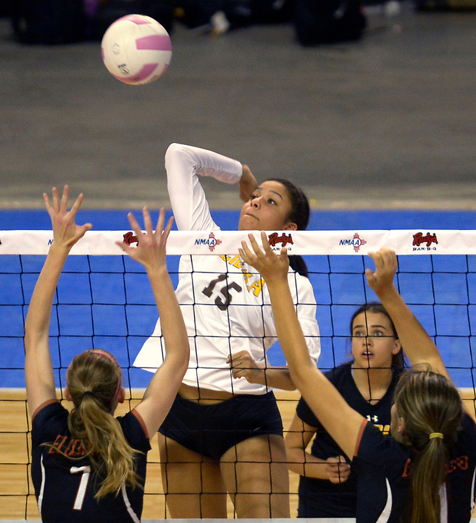 gbs110917i/SPORTS --  Cibola's Angelina Oliver, 15, jumps high for a kill during game against Eldorado in the State Volleyball Championships at the Santa Ana Star Center on Thursday, November 9, 2017. (Greg Sorber/Albuquerque Journal)