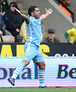 Picture by Andrew Timms/Focus Images Ltd. 07917 236526.14/04/12.Carlos Tevez of Manchester City celebrates scoring his first goal during the Barclays Premier League match against Norwich City at Carrow Road stadium, Norwich.