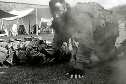 Members of the US 82nd Airborne/505th RCT living History Group take part in the first days battle re-enactment at Fort Paull one reenactor beside a &quot;battlefield casualty&quot; he has just dragged out of the line of fire<br /> <br />   03 May 2015<br />   Image &copy; Paul David Drabble <br />   www.pauldaviddrabble.co.uk