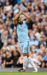 Manchester City's Sergio Aguero celebrates scoring his team's opening goal during the Premier League match at the Etihad Stadiium, Manchester.