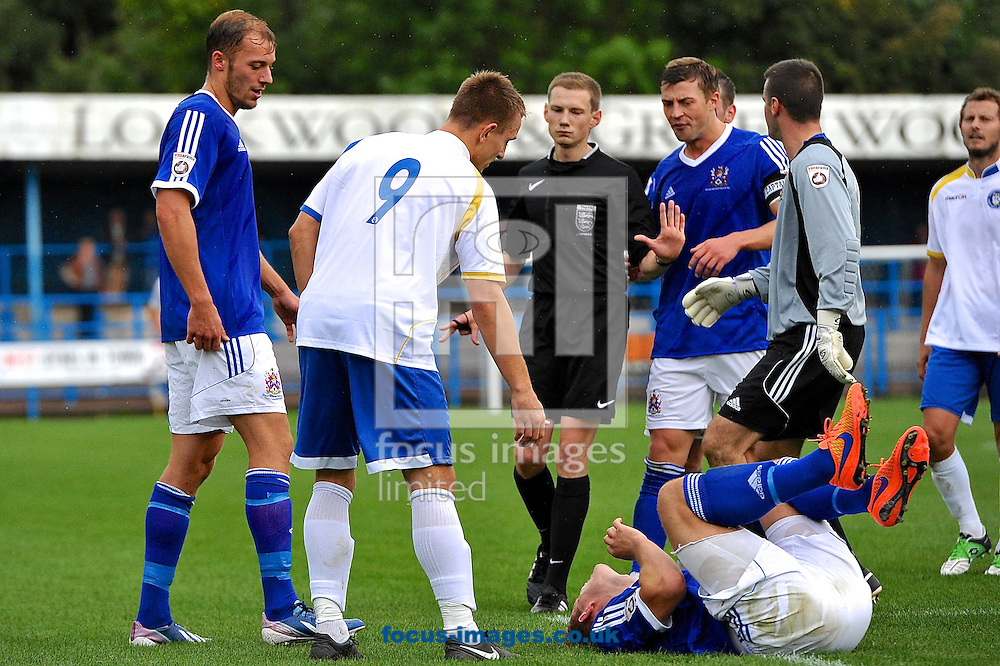 Jake Reed of Lowestoft Town (2nd left) fouls Jack Higgns of Stalybridge Celtic (on floor) during the Conference North match at Bower Fold, Stalybridge<br /> Picture by Ian Wadkins/Focus Images Ltd +44 7877 568959<br /> 12/09/2015