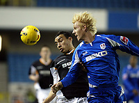 Photo: Chris Ratcliffe.<br /> Millwall v Hull FC. Coca Cola Championship. 14/02/2006.<br /> Craig Fagan of Hull is beaten to the ball by Zak Whitebread of Millwall