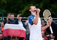 Jerzy Janowicz of Poland celebrates his victory and pass to the third round in men's singles while Day Sixth during The French Open 2013 at Roland Garros Tennis Club in Paris, France.<br /> <br /> France, Paris, May 31, 2013<br /> <br /> Picture also available in RAW (NEF) or TIFF format on special request.<br /> <br /> For editorial use only. Any commercial or promotional use requires permission.<br /> <br /> Mandatory credit:<br /> Photo by © Adam Nurkiewicz / Mediasport