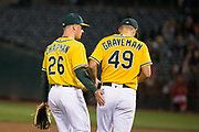 Oakland Athletics third baseman Matt Chapman (26) tries to encourage Oakland Athletics starting pitcher Kendall Graveman (49) during a rough inning against the Los Angeles Angels at Oakland Coliseum in Oakland, California, on September 5, 2017. (Stan Olszewski/Special to S.F. Examiner)