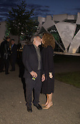 Lisa Gottsegen and Dustin Hoffman. Serpentine Gallery Summer party in a glass and steel pavilion designed by Toyo Ito and Arup. . tuesday 9 July 2002. © Copyright Photograph by Dafydd Jones 66 Stockwell Park Rd. London SW9 0DA Tel 020 7733 0108 www.dafjones.com