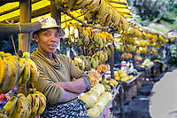 Woman selling bananas at farmer's market. Magical Madagascar Photo Tour. Fine art photography prints
