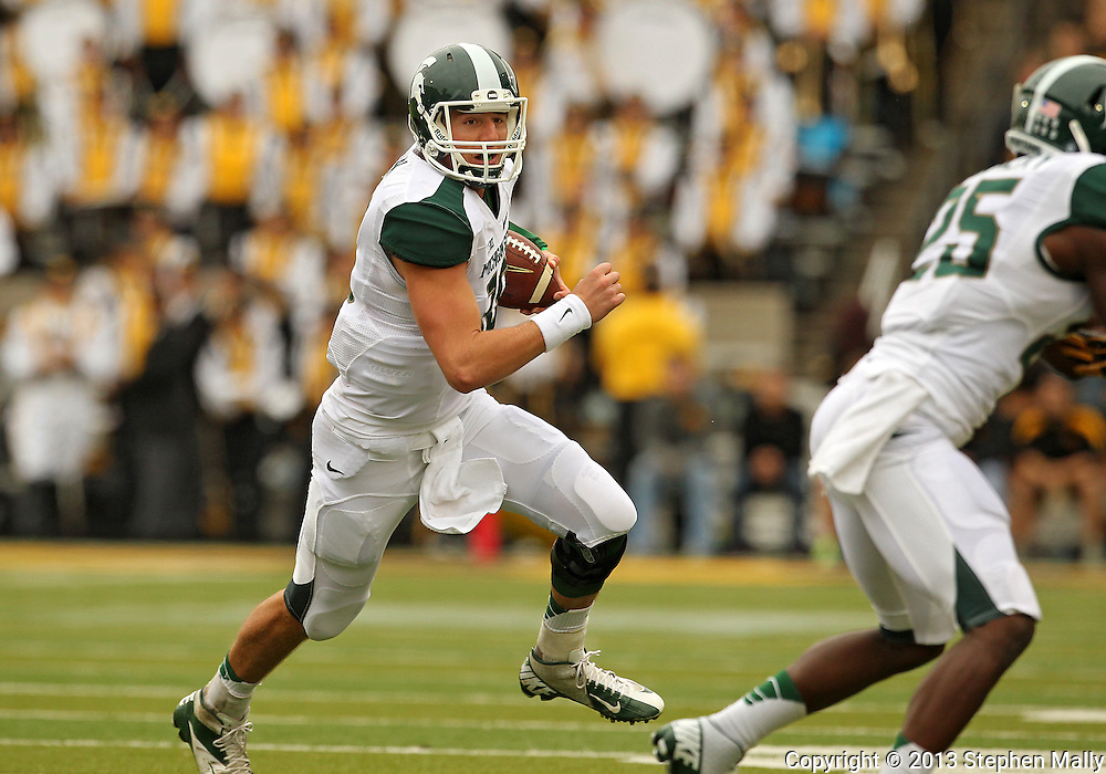 October 6 2013: Michigan State Spartans quarterback Connor Cook (18) scrambles with the ball during the second quarter of the NCAA football game between the Michigan State Spartans and the Iowa Hawkeyes at Kinnick Stadium in Iowa City, Iowa on October 6, 2013.