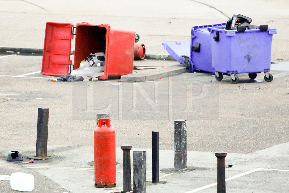 © Licensed to London News Pictures. 14/01/2015. Brighton, UK. Some of the travellers have moved on leaving behind them littler and empty gas canisters. A group of travellers with caravans that moved on to a public space on Black Rock near Brighton Marina have been issued with a Claim Form for Possession of Property on January 14th 2015 after requests from the council to vacate the public space.  Several large rubbish bins have been tipped over with waste and empty gas bottles left lying all over Black Rock and Brighton Beach. Photo credit : Hugo Michiels/LNP