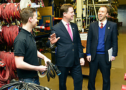© Licensed to London News Pictures. 14/03/2013. London, UK Deputy Prime Minister Nick Clegg (centre) and Skills Minister Matthew Hancock (Right) talk to an apprentice, whilst he services theatrical lighting at the company. Deputy Prime Minister Nick Clegg visits White Light, a company in South West London, to talk to apprentices and launch the Government's response to the Richard Review today 14th March 2013. Photo credit : Stephen Simpson/LNP