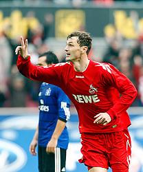 30.10.2010,  Rhein Energie Stadion, Koeln, GER, 1.FBL, FC Koeln vs Hamburger SV, 10. Spieltag, im Bild: 3 Tore! FC Stuermer Milivoje Novakovic (Koeln #11) bejubelt sein 3:2 Fuehrungstreffer. Alle drei hat der Stuermer erziehlt  EXPA Pictures © 2010, PhotoCredit: EXPA/ nph/  Mueller+++++ ATTENTION - OUT OF GER +++++