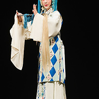 VENICE, ITALY - JULY 29:  Luo Chenxue from the Kunqu Opera of Jiangsu performs at Teatro Goldoni on July 29, 2011 in Venice, Italy. Kunqu Opera, now under the Unesco patronage, originated in the Jiangsu province, dating back to the early Ming dinasty. With a history of more than six hundred years, Kunqu Opera is a traditional type of Chinese drama and one of the most ancient opera forms in China and in the world.