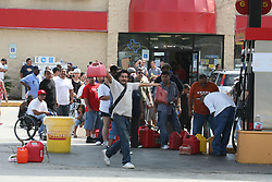 Stock photo of people lined up for gas during a shortage during Hurricane Ike