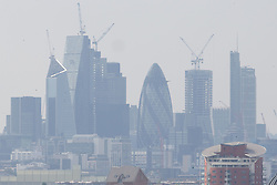 The hazy sunshine partially obscures the City skyline in London, seen from Maze Hill, Greenwich as Mayor Sadiq Khan announces air toxicity alerts for the Capital. London, May 08 2018.