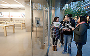 A group of eager shoppers discuss the deals available at the Apple store in City Creek Shopping Center before it opens on Black Friday in Salt Lake City, Friday, Nov. 23, 2012.