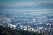 A view of Rio and the Maracana stadium from the Cristo Redentor (Christ statue) at the top of the hill in Rio de Janeiro, Brazil. Photo by Andrew Tobin/Tobinators Ltd