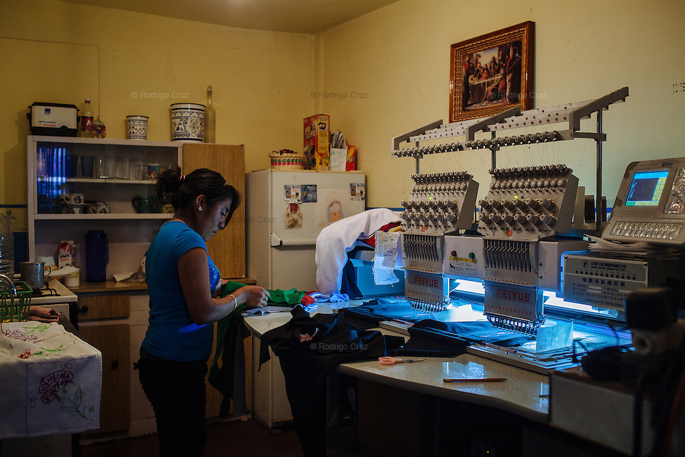 A woman works copying the registered marks of clothes to sell like copies at large scale. Most people work informally into their houses, in Ciudad Nezahualcoyotl, March 17, 2009.