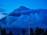 20 JANUARY 2018 - LEGAZPI, ALBAY, PHILIPPINES: Smoke and clouds shroud the peak of Mayon Volcano, the most active volcano in the Philippines. More than 30,000 people have been evacuated from communities on the near the Mayon volcano in Albay province in the Philippines. Most of the evacuees are staying at school in communities outside of the evacuation zone.   PHOTO BY JACK KURTZ