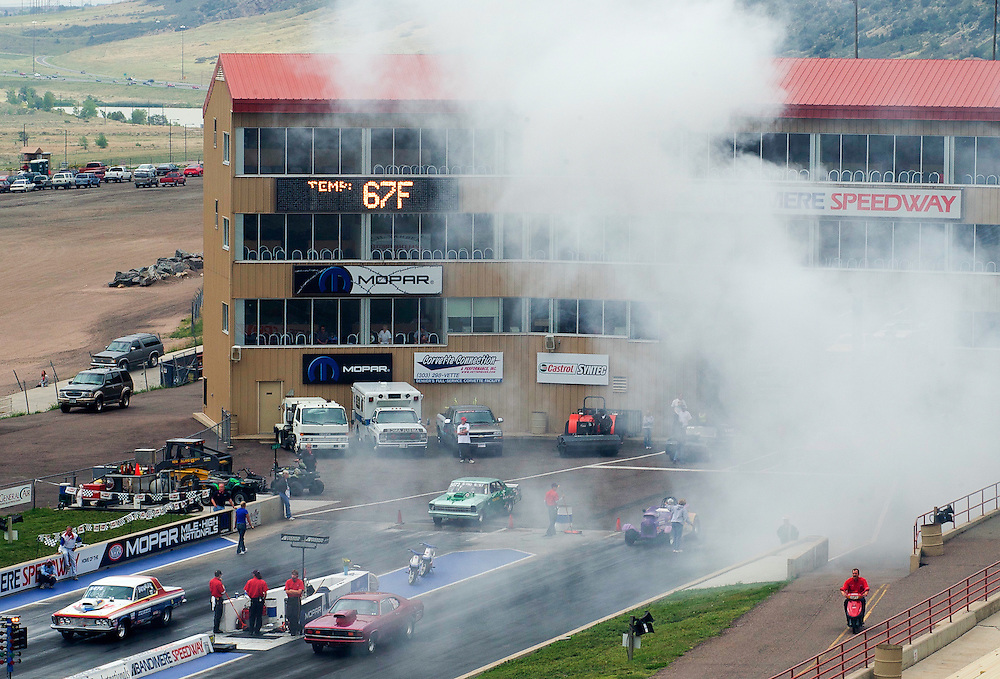 Two cars get ready to race at the start line of a drag race at Bandimere Race Track in Morrison, CO.