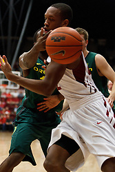 January 27, 2011; Stanford, CA, USA;  Oregon Ducks guard Johnathan Loyd (back) knocks the ball away from Stanford Cardinal guard Jarrett Mann (22) during the second half at Maples Pavilion.  Oregon defeated Stanford 67-59.