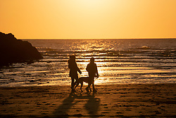 © Licensed to London News Pictures. 31/03/2020. Perranporth, Cornwall, UK. Sunset on the near deserted beach at the popular holiday destination, Perranporth, in Cornwall Photo credit: MARK HEMSWORTH/LNP